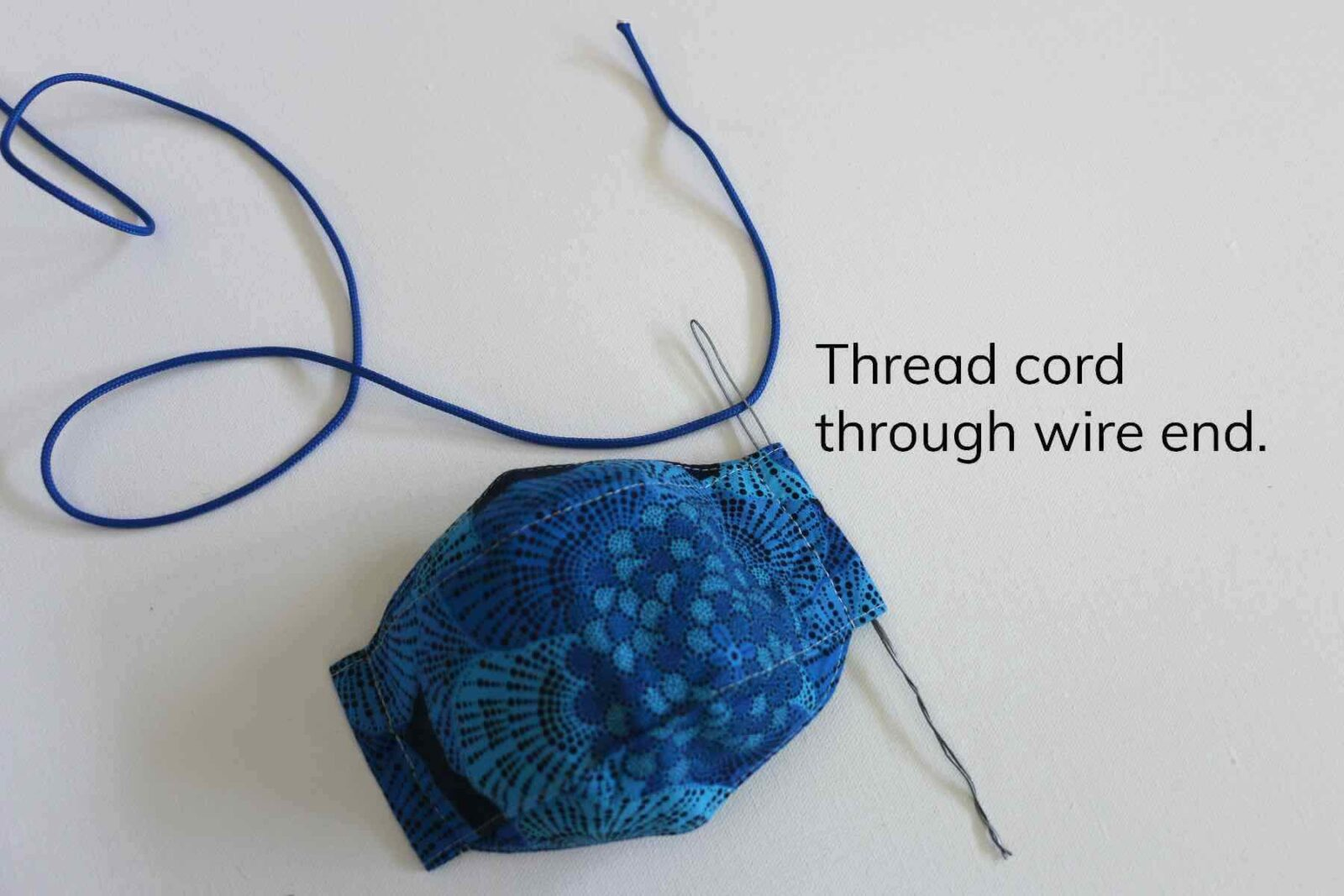 3. Thread cord through loop end of wire